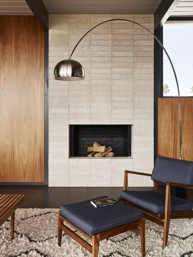 classic midcentury cinder block fireplace with Danish chair and coffee table