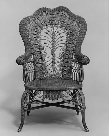 black and white image of a rattan chair