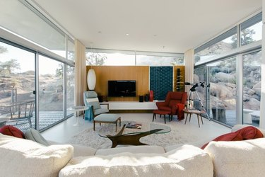 midcentury-style living room with large windows and a noguchi-style coffee table