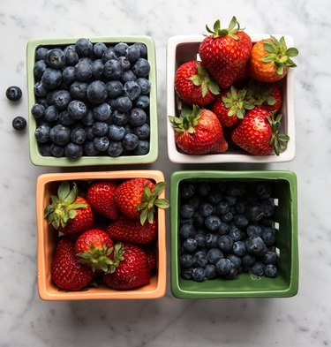 Berries in different ceramic baskets