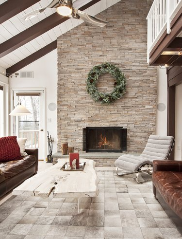Rustic living room idea with floor to ceiling stone fireplace
