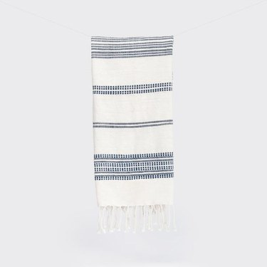 White hand towel with thin blue stripes