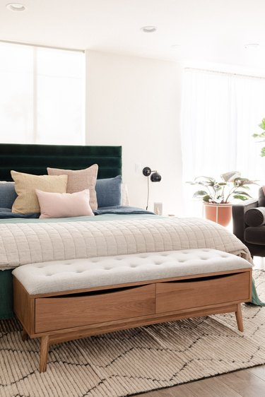 bed bench in front of bed with tufted seat and two drawers for storage