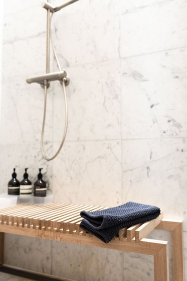 wooden bench in marble shower