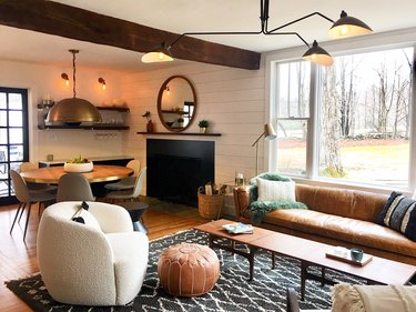 rustic living room lighting idea with chandelier and shiplap with wood beams