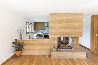 original double-sided midcentury brick fireplace