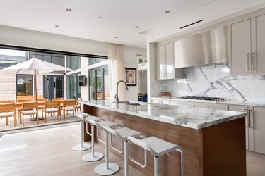 kitchen with off white cabinets and white island