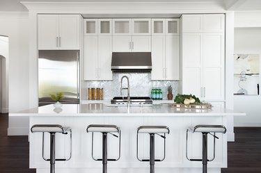 crisp white kitchen and white island