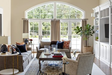 beige living room idea with orange and navy living room