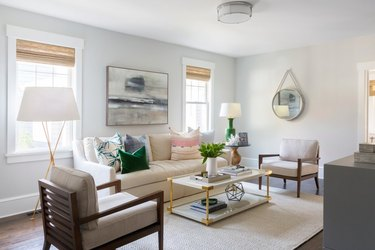 green living room idea with green accessories in neutral space
