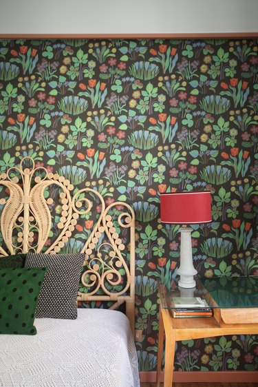 bedroom floral wallpaper with wicker bed