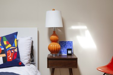 Orange and blue color in bedroom