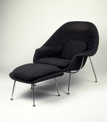 black chair with foot stool