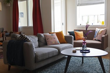 living room space with two couches and round coffee table