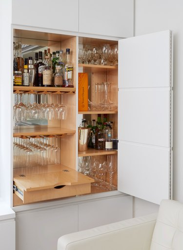 living room bar idea in built-in cabinet with shelving and drawers