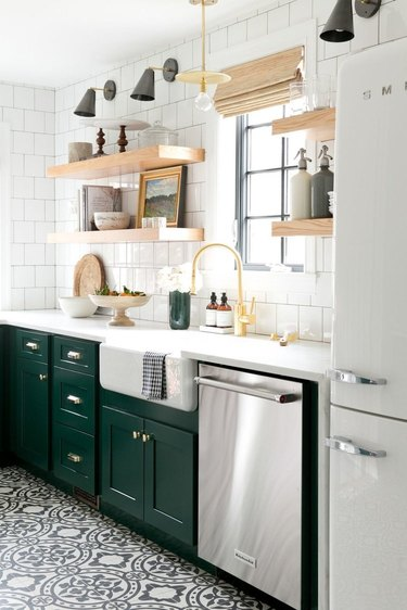 Kitchen organization ideas in space with white tile backsplash and green cabinetry