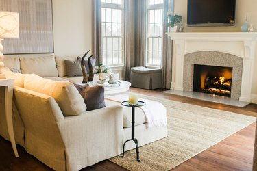 beige living room idea with gray accents and fireplace