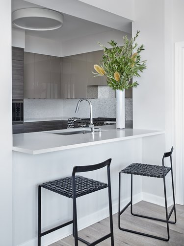 small kitchen decorating ideas in white space with barstools at countertop