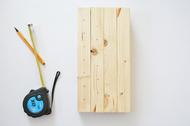 Tape measure and wooden bee house