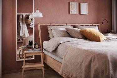bedroom storage idea with IKEA stool as nightstand