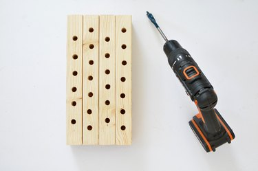 Bee house with holes drilled with power drill