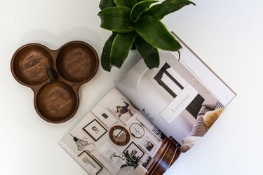 """Kirsten Grove book """"Simply Styling"""" on table with plant"""