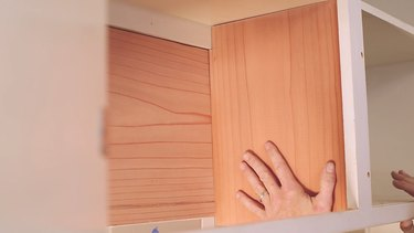 Gluing redwood side board to cabinet