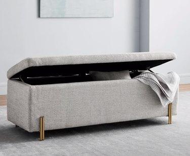 basement storage ideas with gray velvet bench