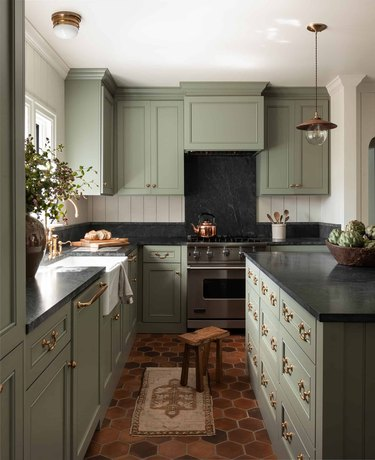 Green and traditional kitchen island in green kitchen