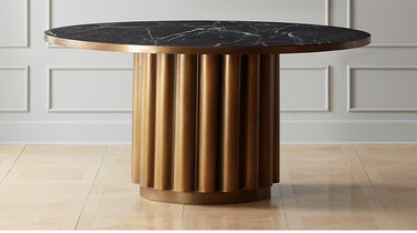 CB2 Cypher Black Marble Dining Table, $1,899