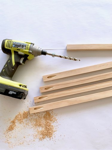 Drill and wood dowels for towel rack DIY