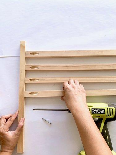 Placing wood dowels together for towel rack DIY