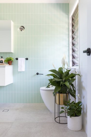 bathroom idea with mint green subway tile for minimalist decorating on a budget