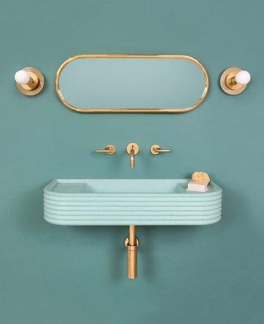 Turqoise bathroom sink idea with brass fixtures