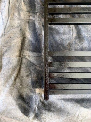 Black spray painted towel rack DIY