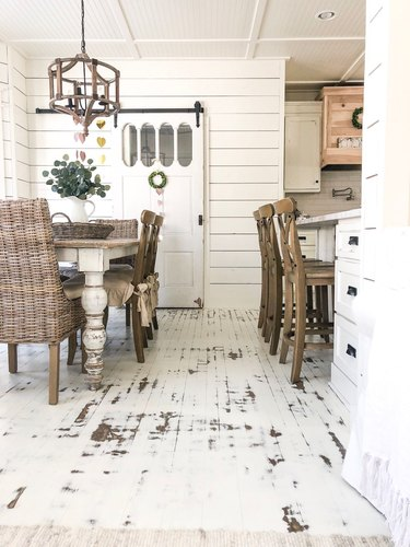 farmhouse space with white distressed kitchen floor paint
