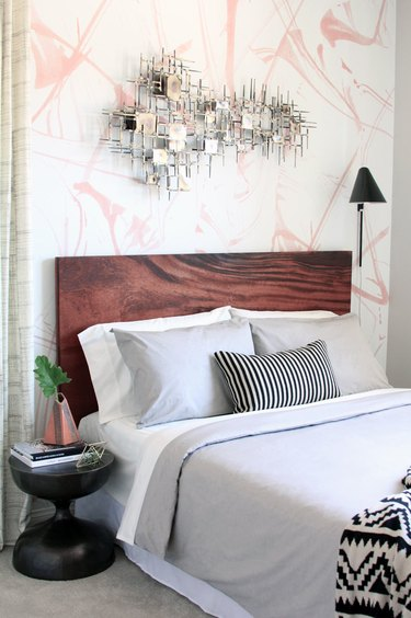 bedroom wall decor idea with abstract at and wallpaper
