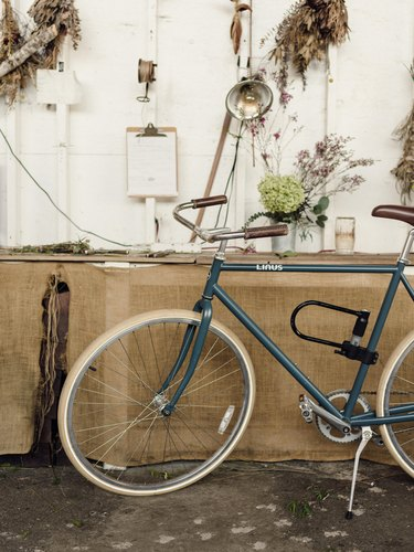 Vintage bike and flowers hung on a wall