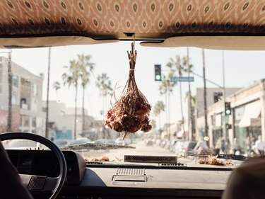A dried bouquet hanging from a rear-view mirror