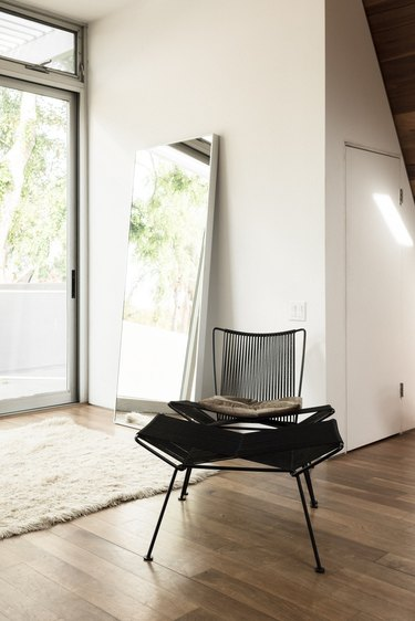 High ceilings and black chair, natural light