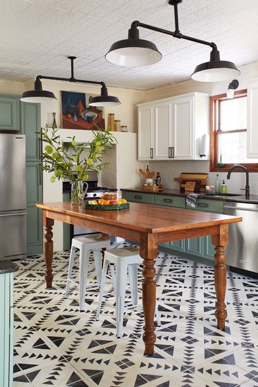cream and black patterned kitchen floor paint and wooden table