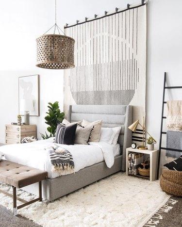bedroom wall decor idea with oversize area rug