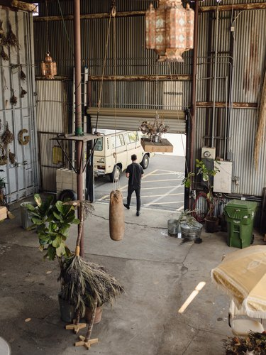 Spencer Falls walks in the entrance of his studio