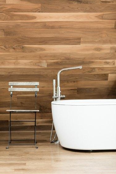 Bathtub, wood walls
