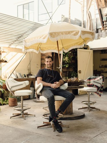 Spencer Falls relaxes on the patio at his studio