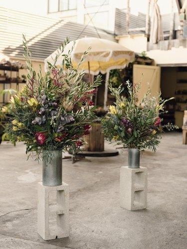 Bouquets of flowers set on cinder blocks