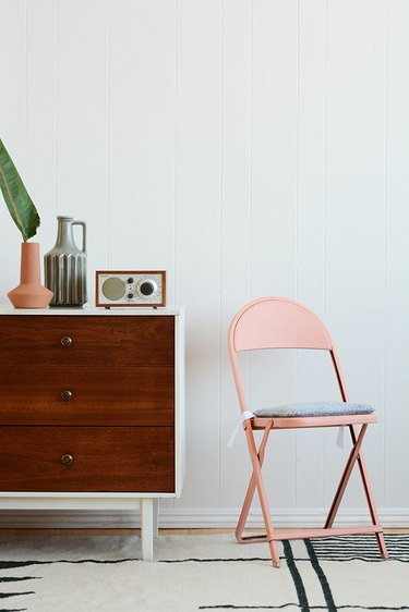 Folding chair with DIY seat cushion.