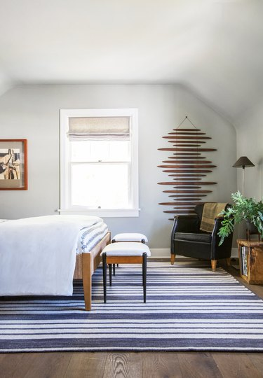 Bedroom wall decor idea with hanging artwork