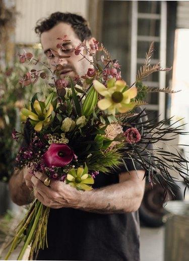 Spencer Falls designs a floral bouquet