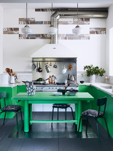 green kitchen cabinets and black kitchen floor paint